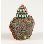 AN ISLAMIC FILIGREE SILVER SCENT BOTTLE with coral and turquoise stones. 2.5ins