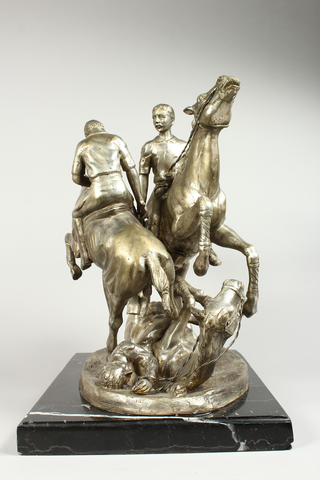 AFTER F. REMMINGTON A SILVER BRONZE GROUP OF TWO RIDERS ON HORSEBACK, a horn and rider on the floor. - Image 14 of 16