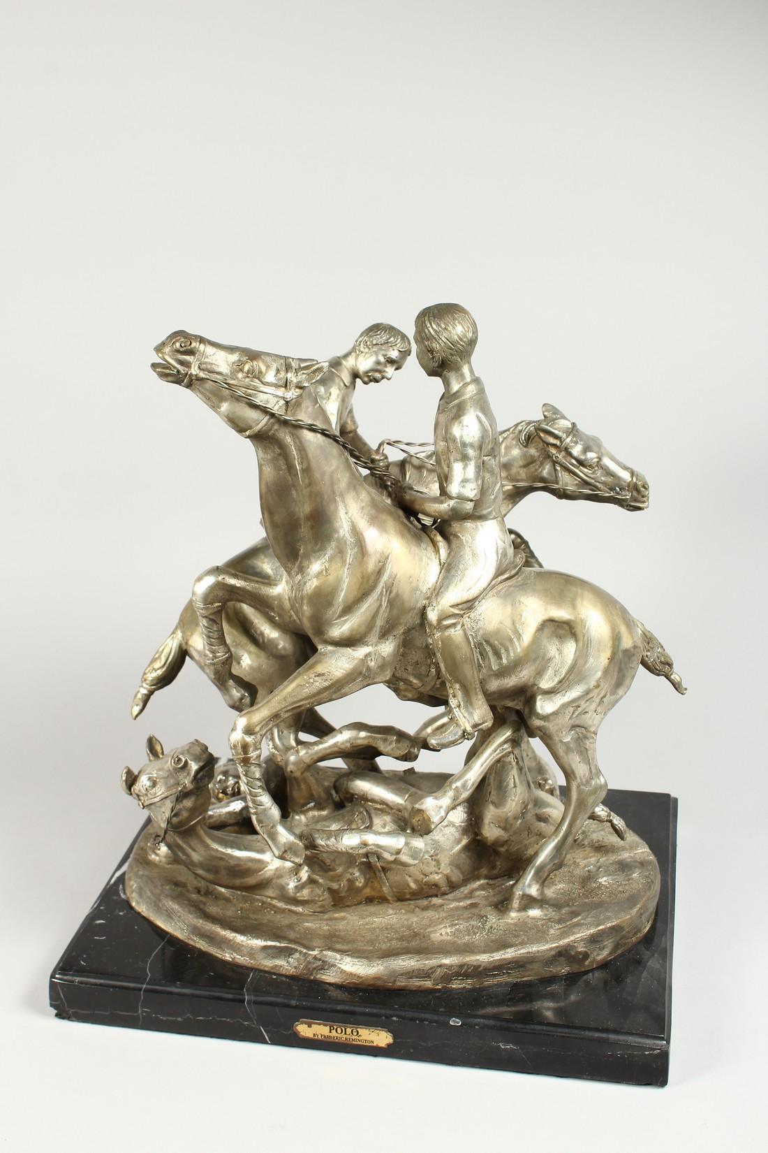 AFTER F. REMMINGTON A SILVER BRONZE GROUP OF TWO RIDERS ON HORSEBACK, a horn and rider on the floor. - Image 3 of 16