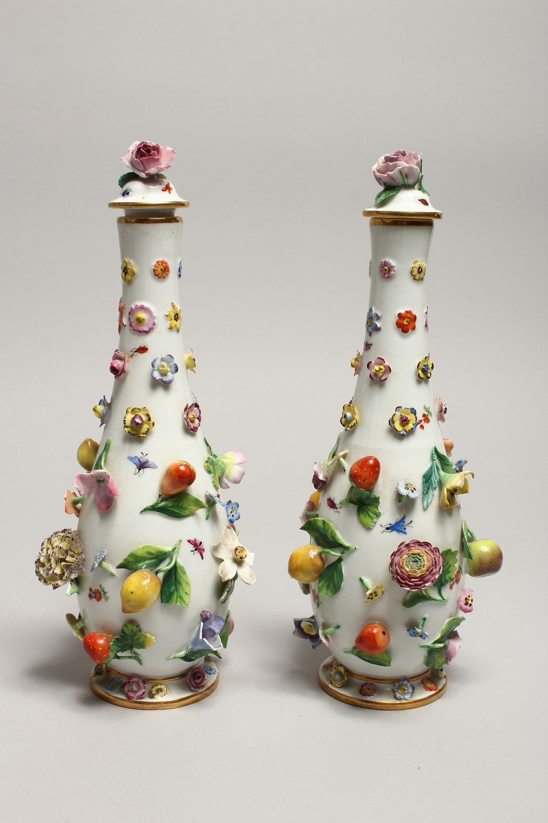 A GOOD PAIR OF MEISSEN FLOWER AND FRUIT ENCRUSTED VASES AND COVERS. Cross swords mark in blue. 10. - Image 2 of 8
