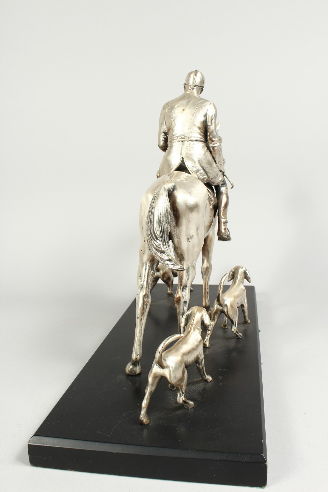 A SILVERED BRONZE GROUP HORSE AND RIDER, with their dogs, on a wooden base. 17ins long, 12ins high. - Image 7 of 10