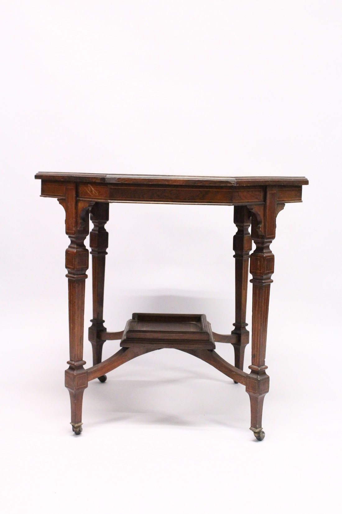 A GOOD VICTORIAN ROSEWOOD OCTAGONAL CENTRE TABLE with inlaid top, tapering legs with casters and - Image 2 of 5
