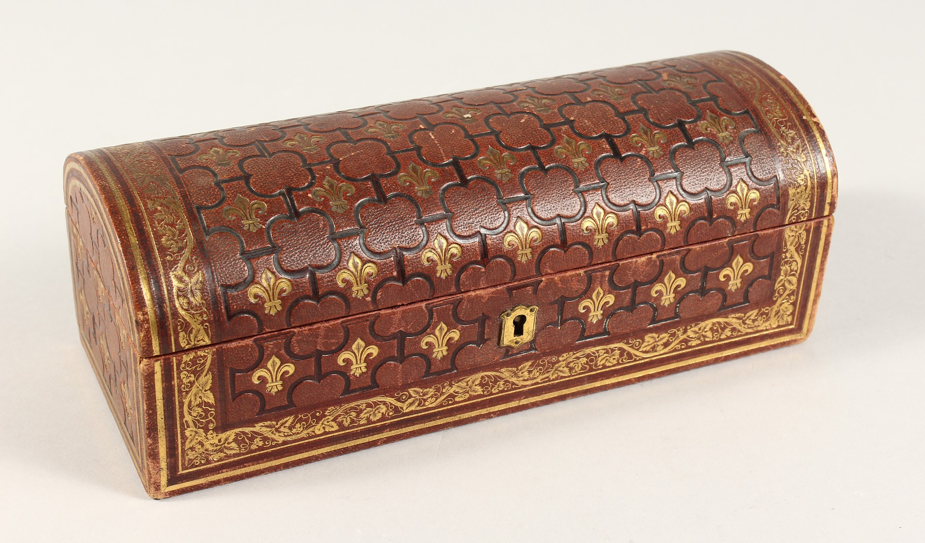 A FRENCH FLEUR D LYS DOMED LEATHER BOX 9.5ins long