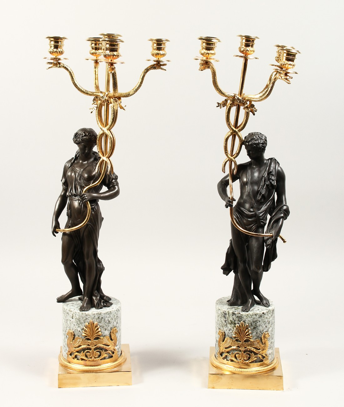 A LARGE PAIR OF THOMAS HOPE DESIGN, ORMOLU AND BRONZE CLASSICAL CANDLESTICKS with a pair of
