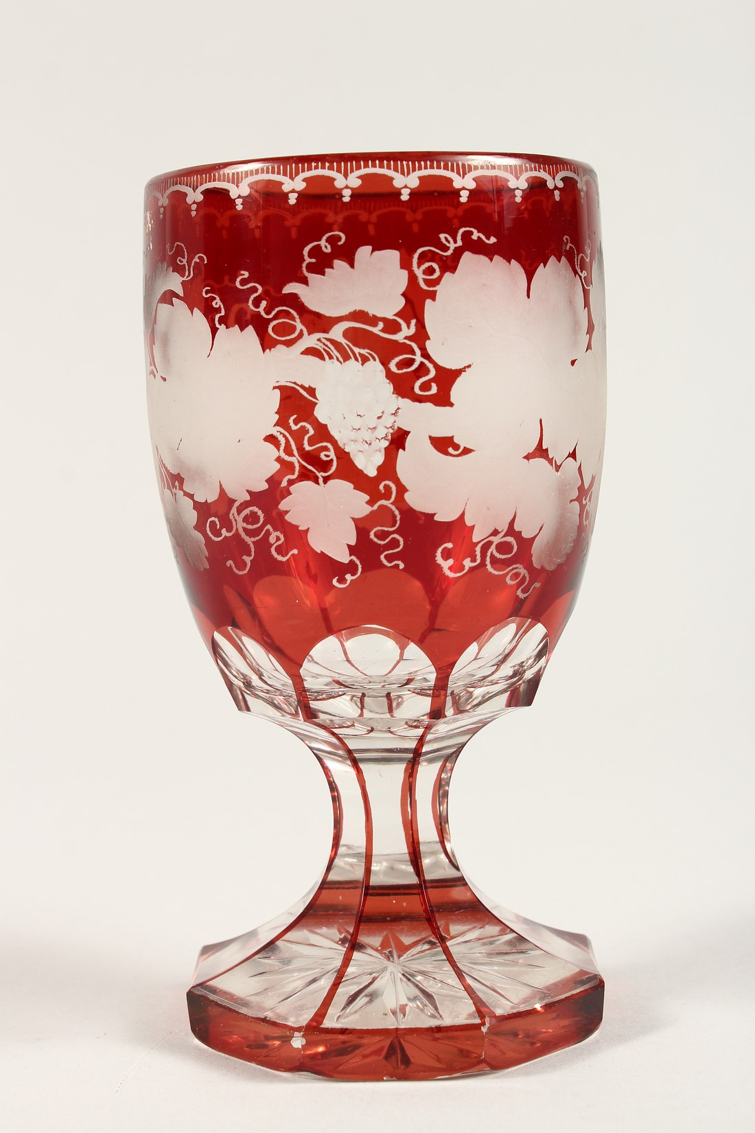 A GOOD BOHEMIAN RUBY GLASS GOBLET ethched with fruiting vines on an octagonal base. 6ins high. - Image 4 of 5