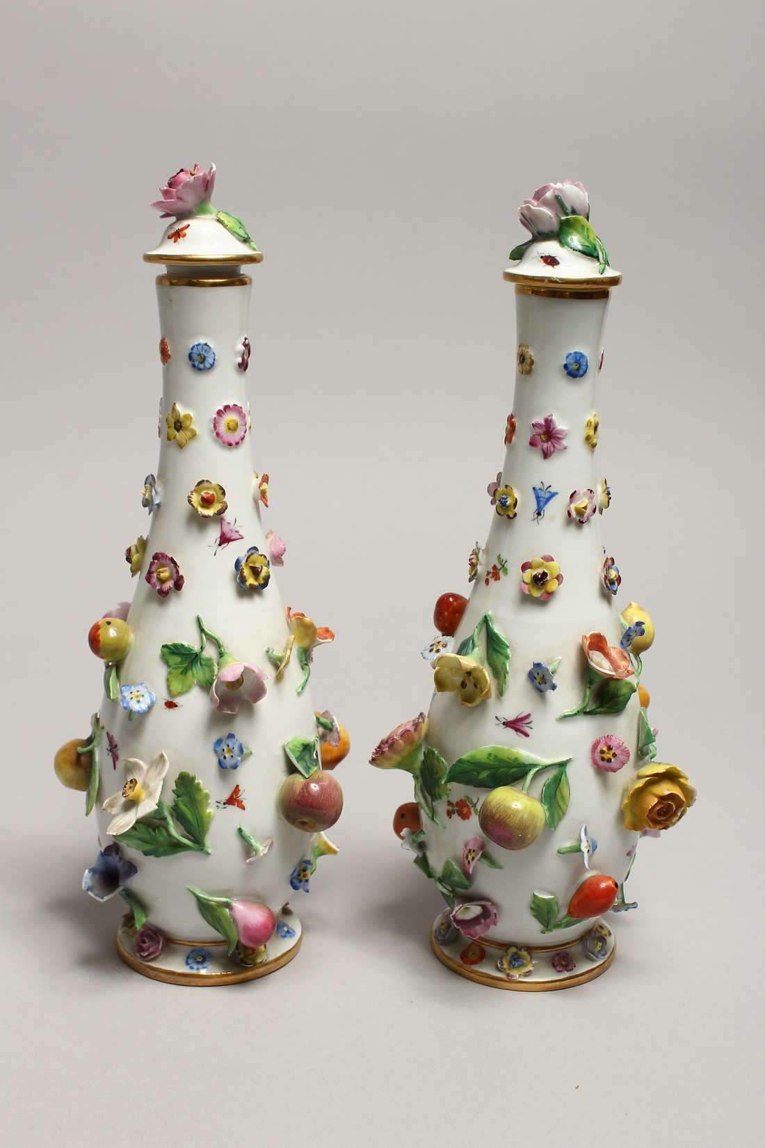 A GOOD PAIR OF MEISSEN FLOWER AND FRUIT ENCRUSTED VASES AND COVERS. Cross swords mark in blue. 10. - Image 3 of 8