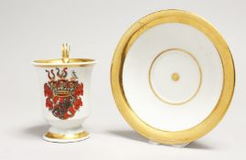 A BERLIN PORCELAIN CUP AND SAUCER, the cup with a crest. Blue septre mark.