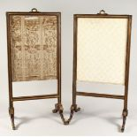 A PAIR OF GOOD QUALITY BRASS INLAID FIRE SCREENS on curving legs with brass feet. 2ft 10ins high x