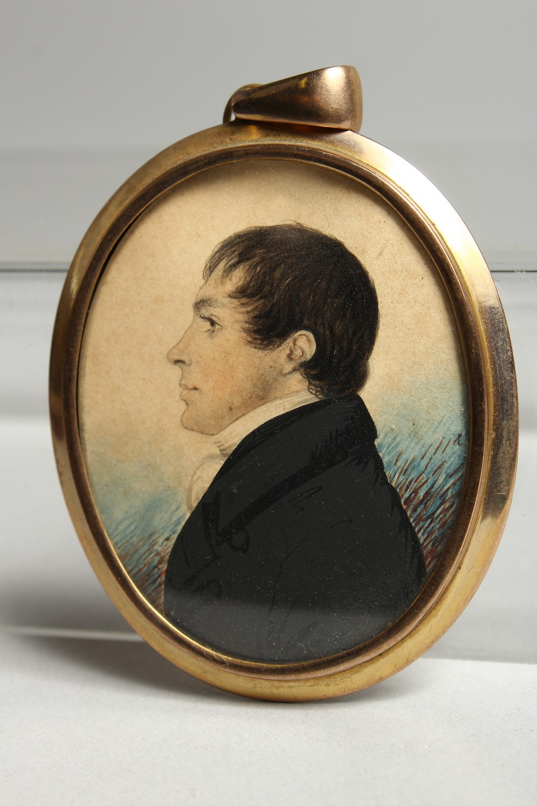 AN EARLY VICTORIAN OVAL MINIATURE OF A GENTLEMAN in a gilt frame. 2.25ins x 1.75ins - Image 2 of 7