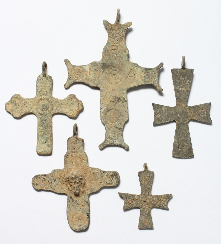 FIVE MEDIUM METAL ROMAN CROSSES. 3ins long