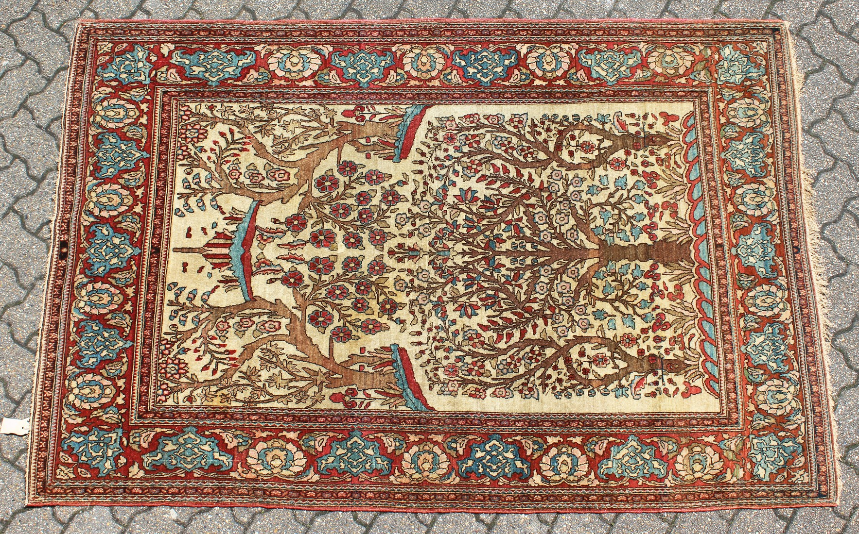 """AN EARLY 20TH CENTURY ISFAHAN """"TREE OF LIFE"""" RUG, beige ground, with a red ground floral border. 7ft"""