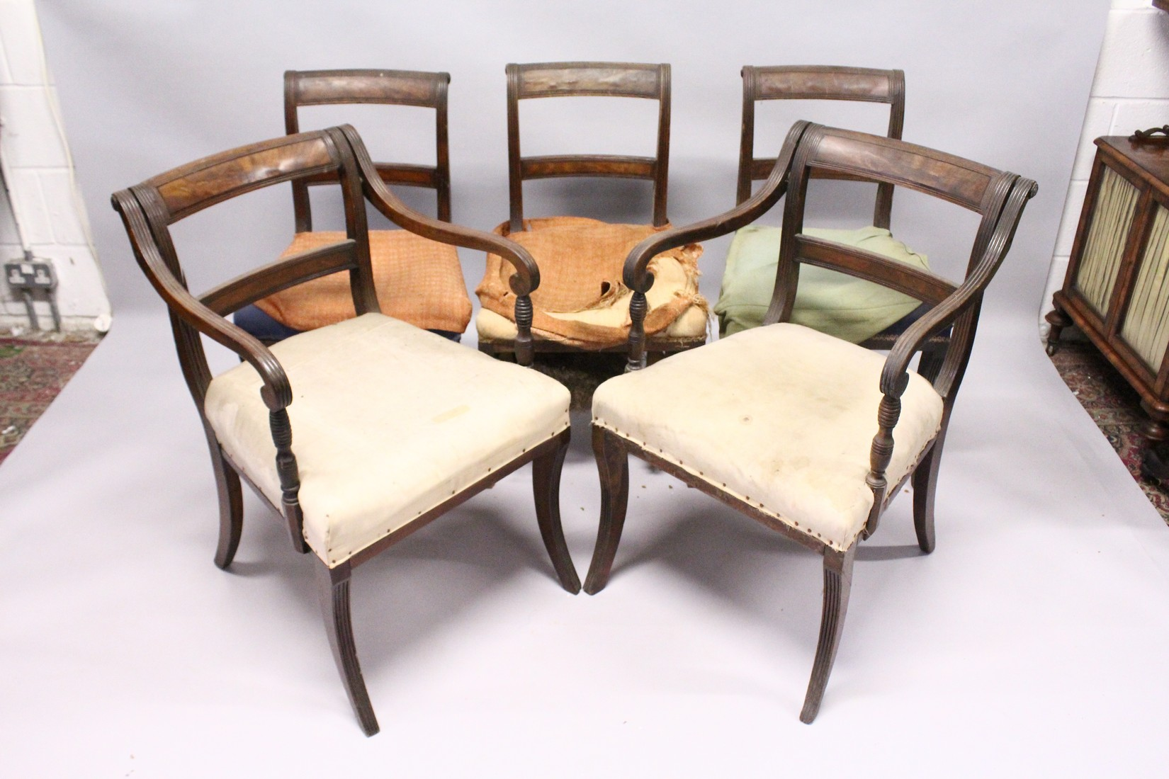 A PAIR OF MAHOGANY, SABRE LEG ARM CHAIRS and three matching single chairs. - Image 2 of 5