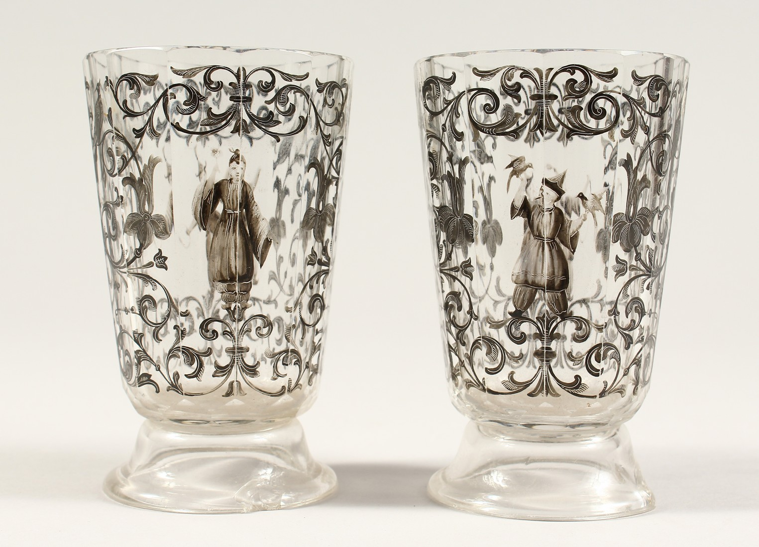 A GOOD PAIR OF BOHEMIAN GLASS TWELVE SIDED BEAKERS, painted with Turkish figures, scrolls and birch.