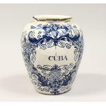 "AN EARLY TIN GLAZED BLUE AND WHITE DRUG JAR ""CUBA"". 9.5ins high (AF)."