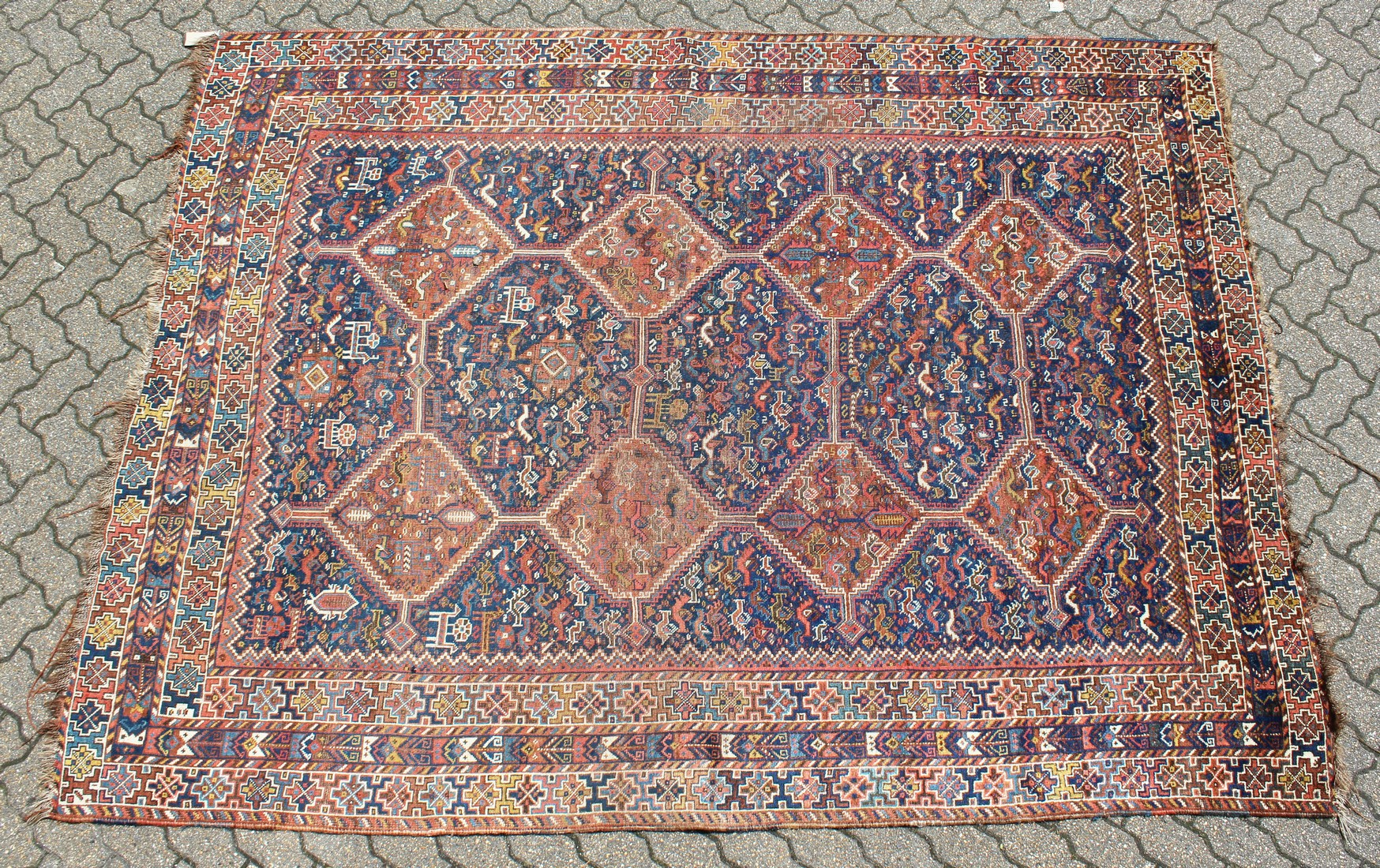 A GOOD PERSIAN CARPET with five large medallions, eight small medallions within a triple row border.