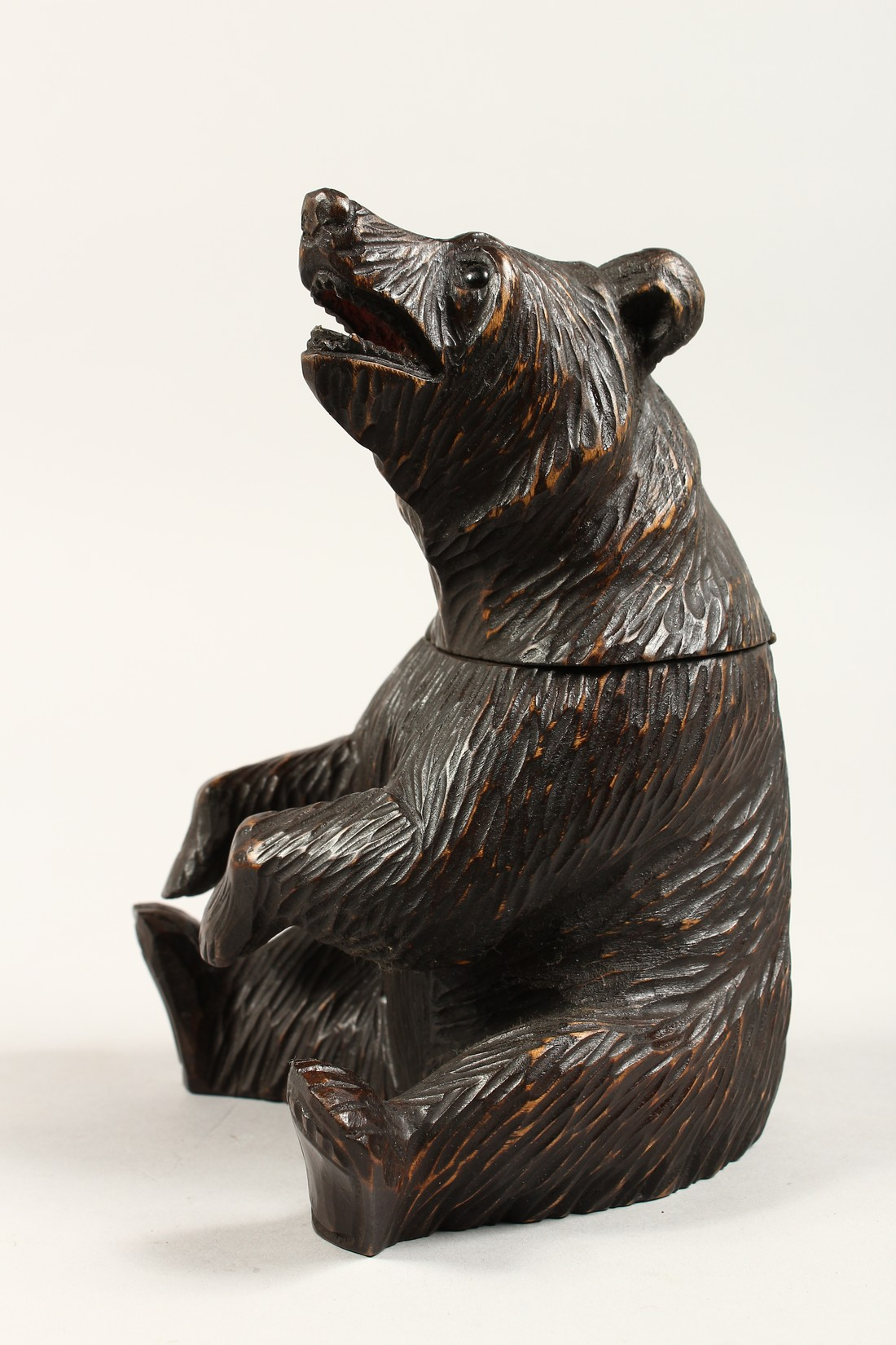 A BLACK FOREST CARVED WOOD BEAR CADDY. 8ins high. - Image 2 of 4