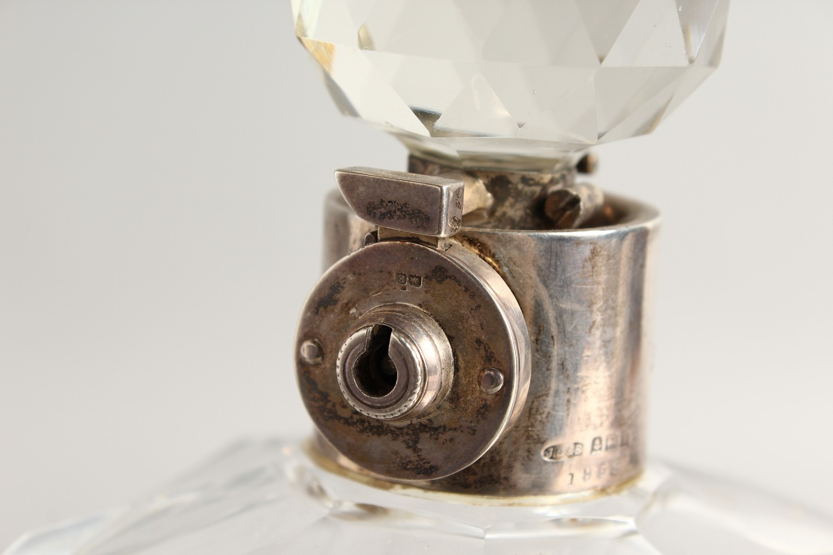 A HEAVY SQUARE GLASS WHISKY DECANTER AND STOPPER with silver band. - Image 2 of 3