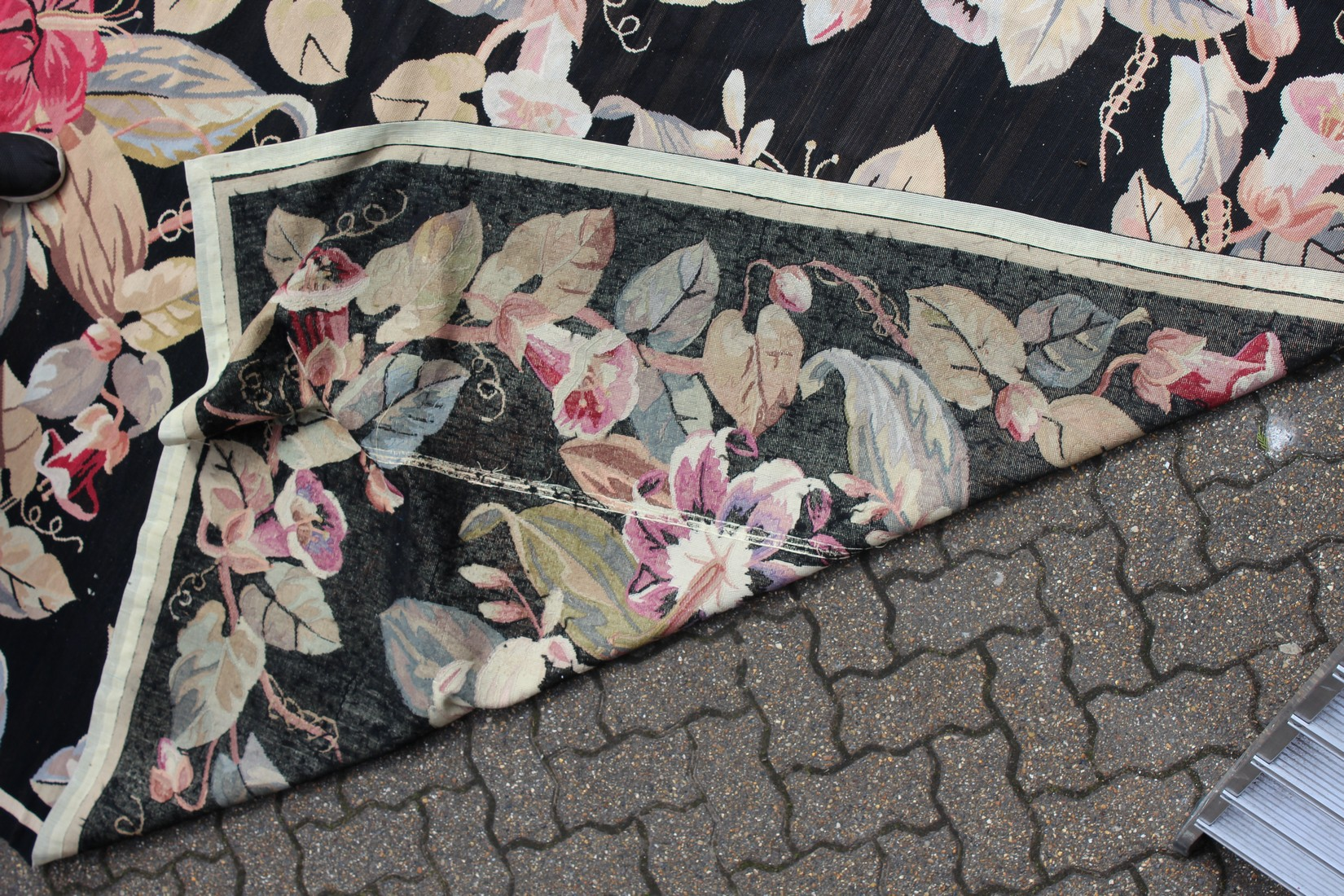 A LARGE ABUSSON STYLE TAPESTRY WALL HANGING, black ground, with floral decoration. 14ft 2ins x - Image 4 of 4