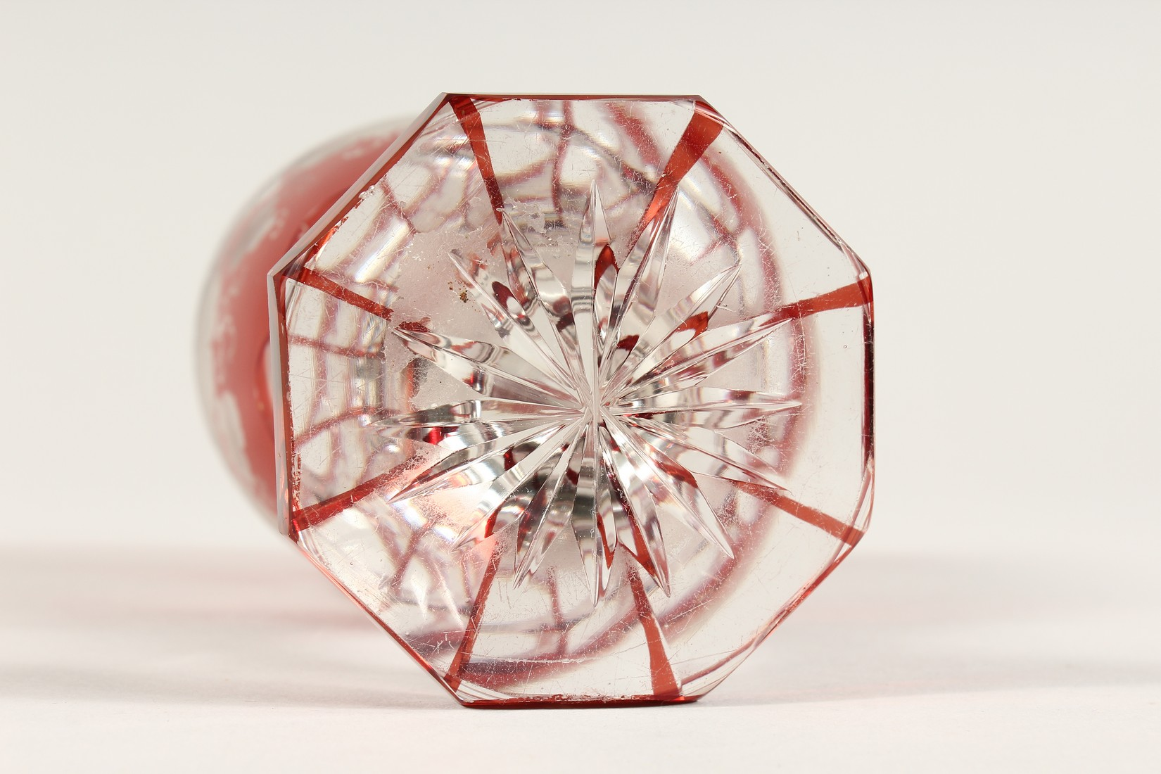 A GOOD BOHEMIAN RUBY GLASS GOBLET ethched with fruiting vines on an octagonal base. 6ins high. - Image 5 of 5