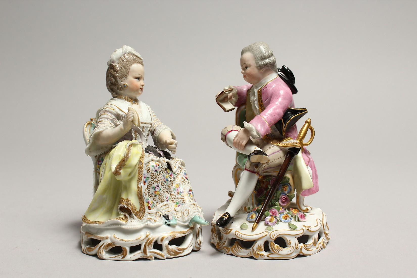 A GOOD PAIR OF MEISSEN PORCELAIN FIGURES, a young man reading a book, a girl sewing. Cross swords - Image 2 of 8