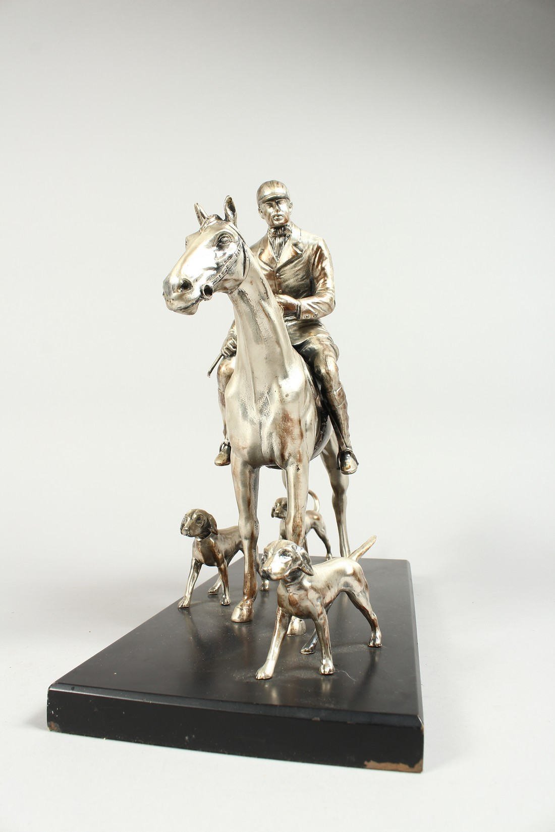 A SILVERED BRONZE GROUP HORSE AND RIDER, with their dogs, on a wooden base. 17ins long, 12ins high. - Image 3 of 10