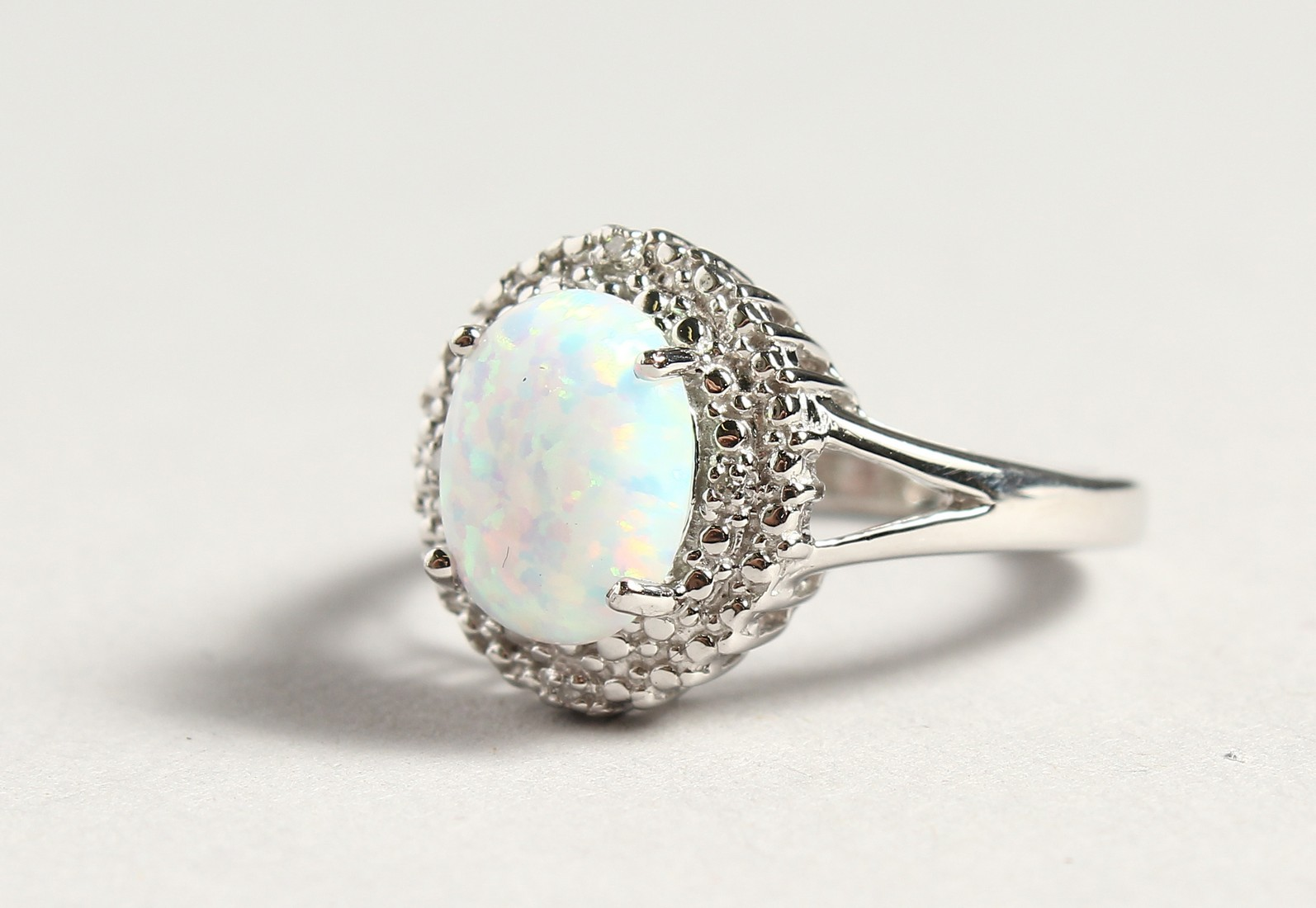A SILVER OPALITE AND DIAMOND CLUSTER RING