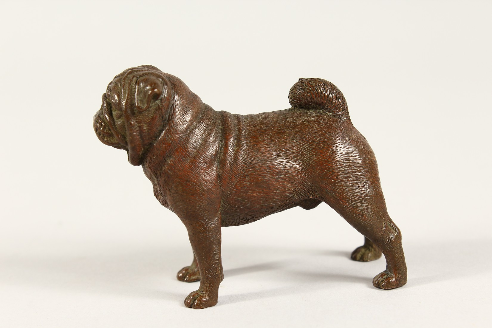 A SMALL HEAVY BRONZE PUG DOG 3ins long - Image 2 of 3