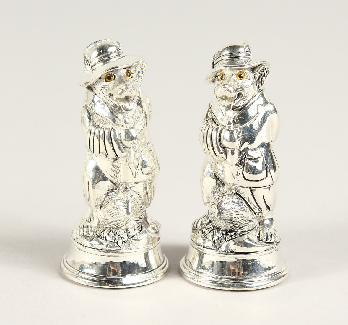 A PAIR OF SILVER PLATE FOX SALT AND PEPPERS