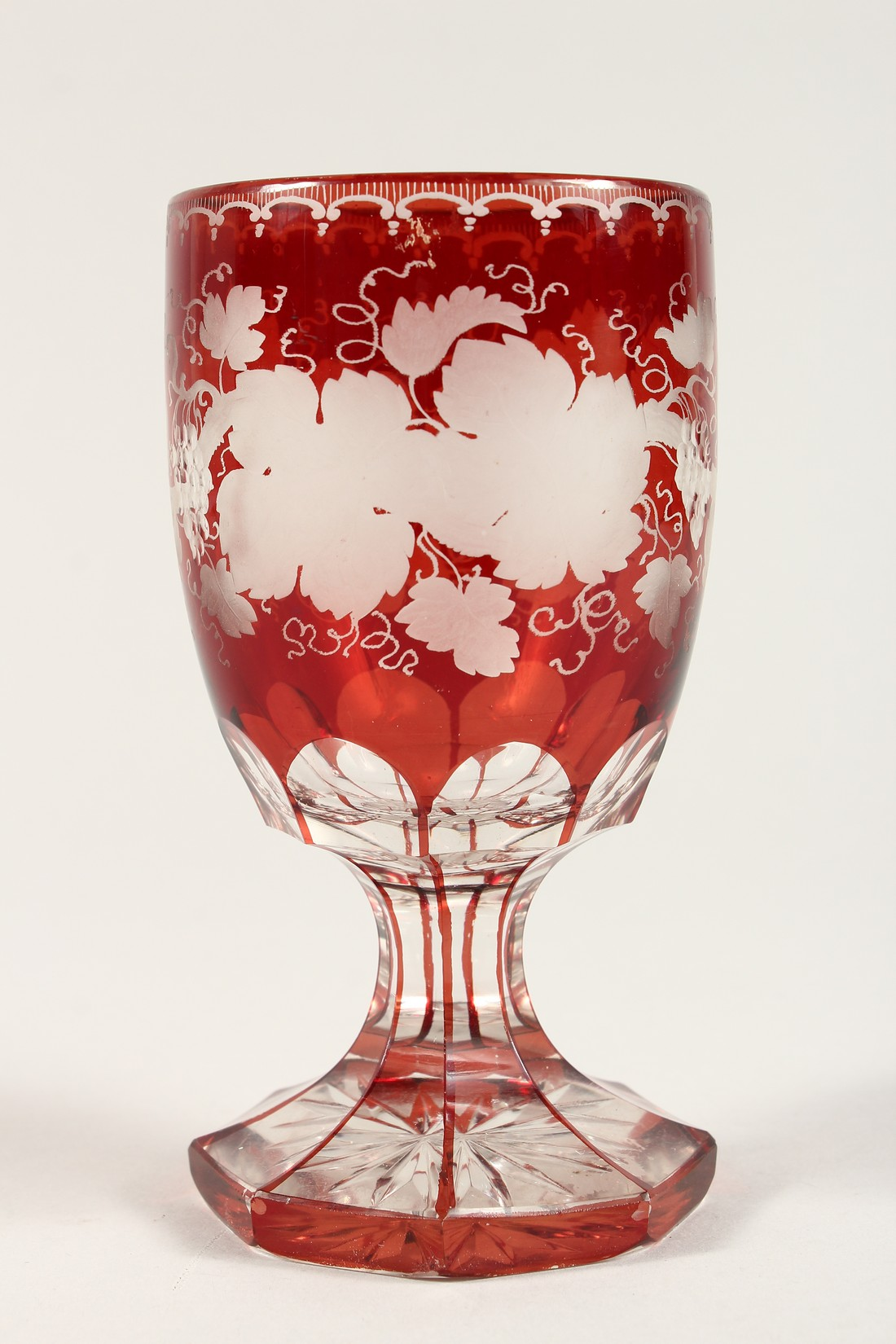 A GOOD BOHEMIAN RUBY GLASS GOBLET ethched with fruiting vines on an octagonal base. 6ins high. - Image 3 of 5