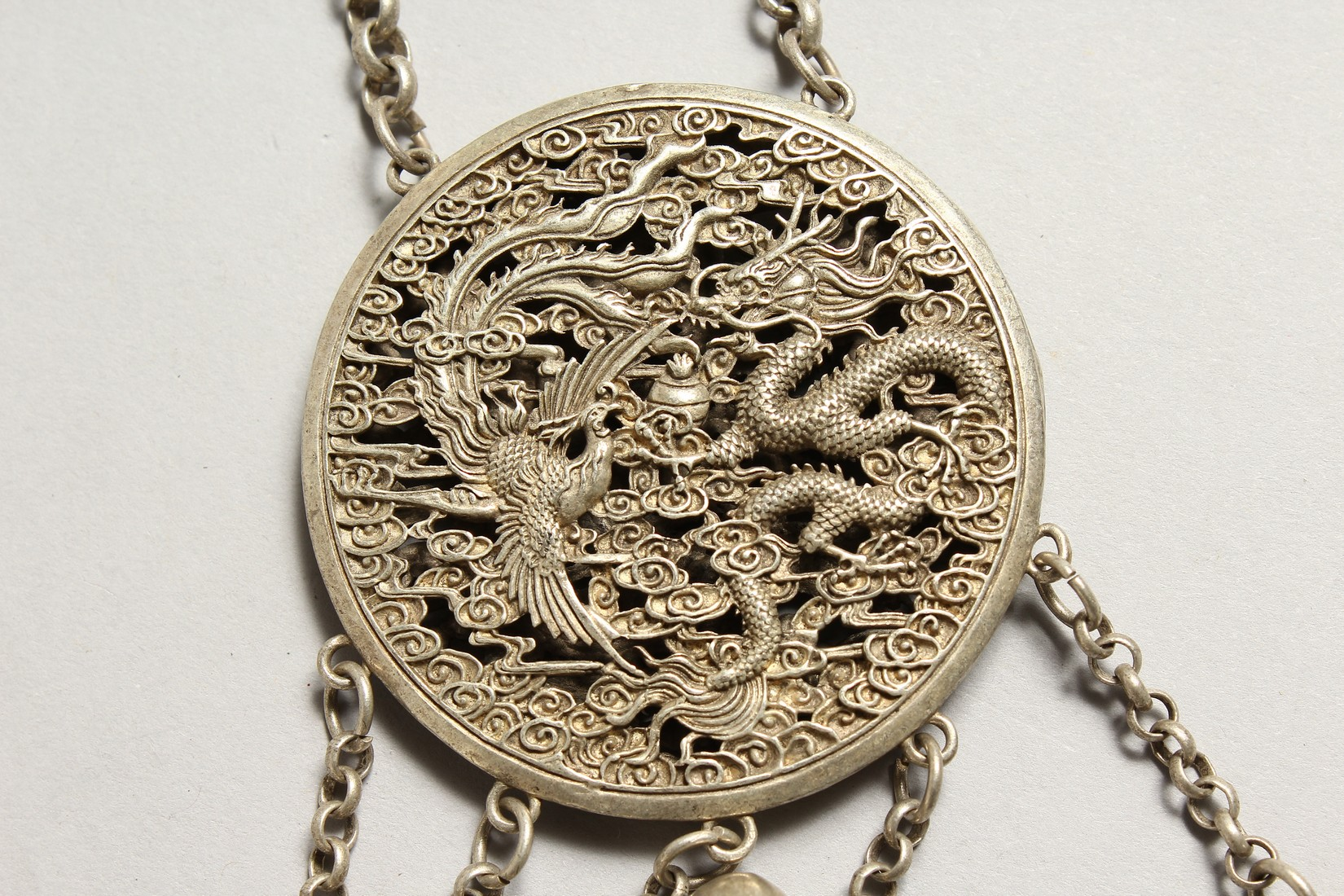 A CHINESE SILVER YIN-YANG PENDANT on a chain with dragon and phoenix. - Image 4 of 4