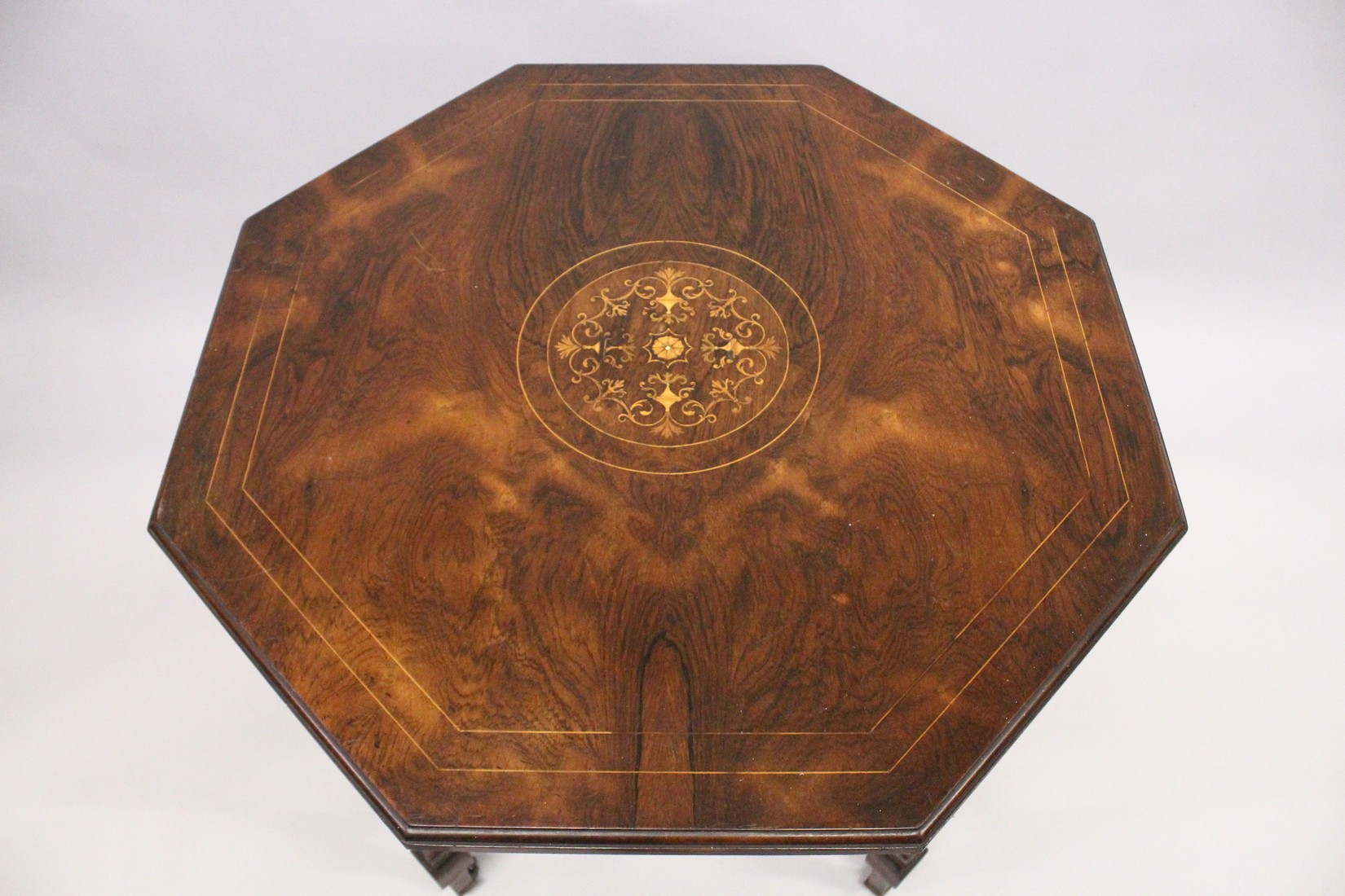 A GOOD VICTORIAN ROSEWOOD OCTAGONAL CENTRE TABLE with inlaid top, tapering legs with casters and - Image 3 of 5