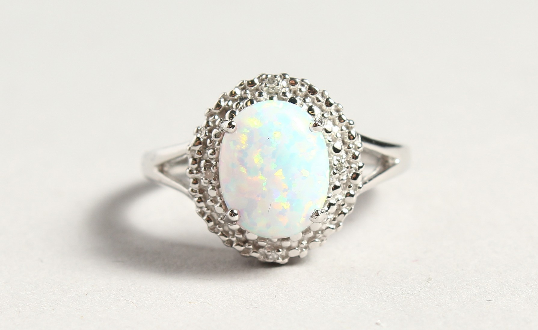 A SILVER OPALITE AND DIAMOND CLUSTER RING - Image 2 of 6