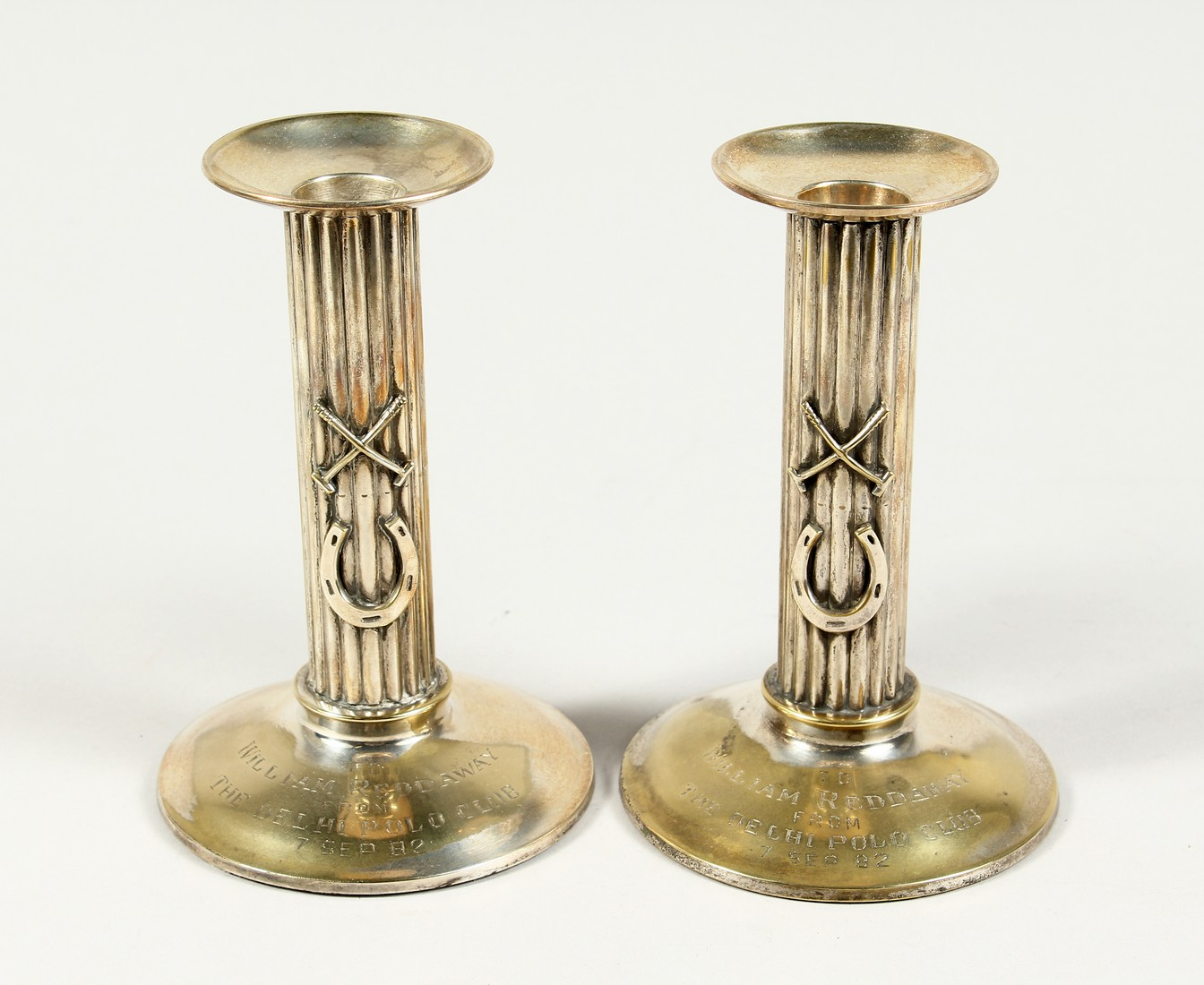 A PAIR OF POLO PRESENTATION CANDLESTICKS, 'To William Reddaway From The Delhi Polo Club', with cross