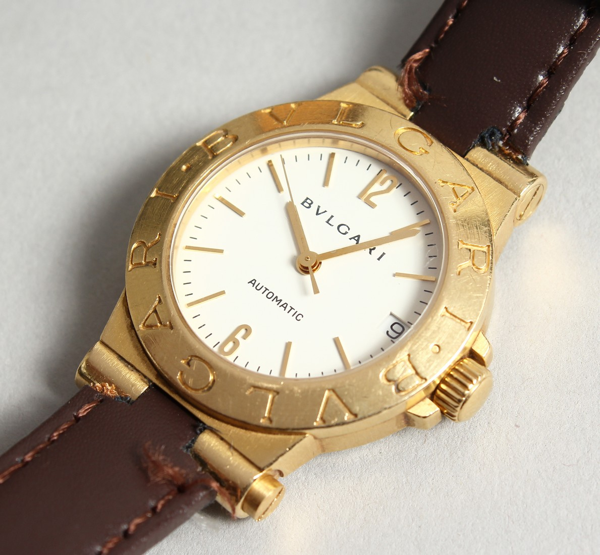 AN 18CT. GOLD BULGARI WRIST WATCH with leather strap, in original box.