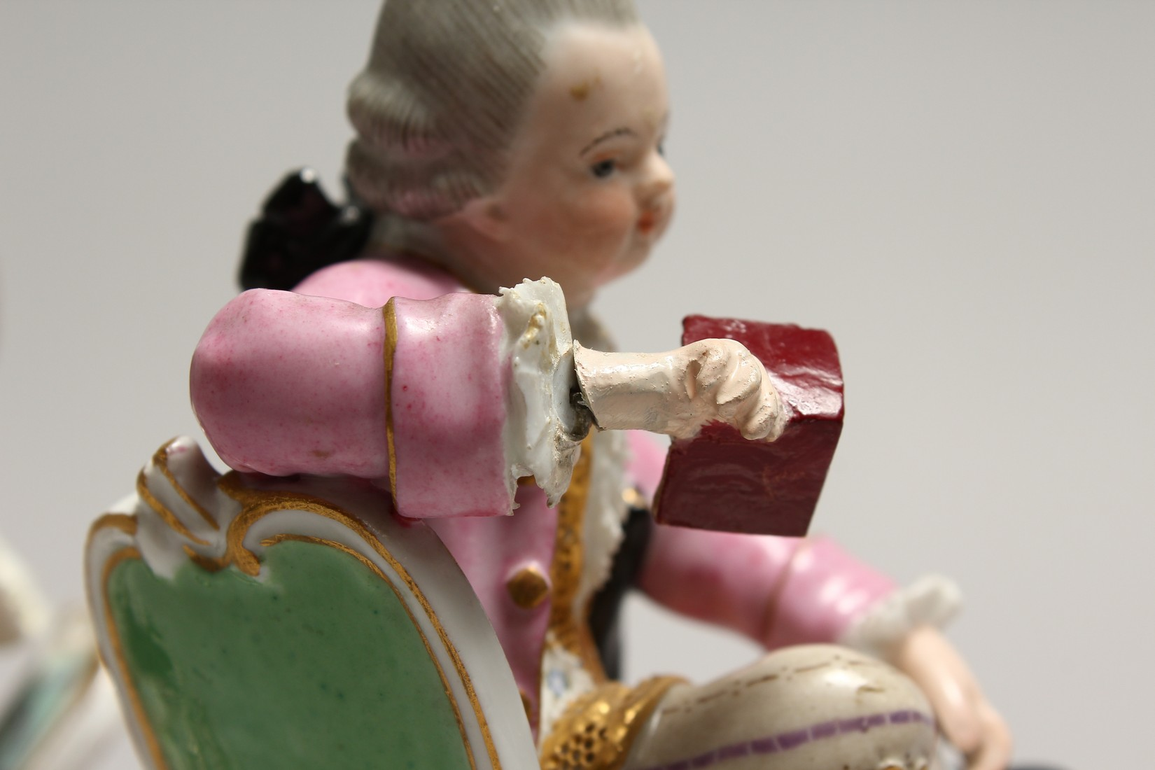 A GOOD PAIR OF MEISSEN PORCELAIN FIGURES, a young man reading a book, a girl sewing. Cross swords - Image 5 of 8