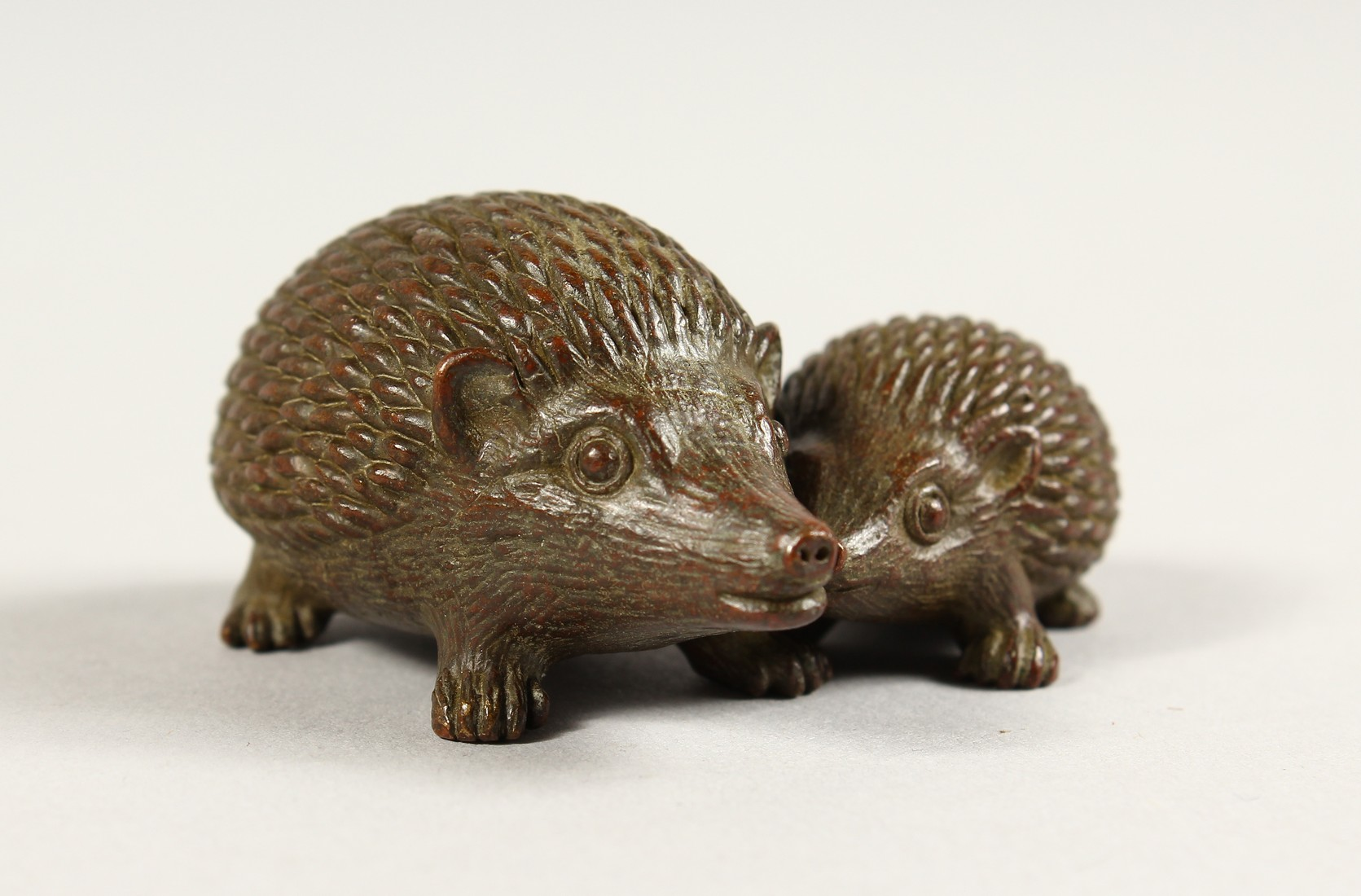 TWO JAPANESE BBRONZE HEDGEHOGS 2ins & 1.5ins long