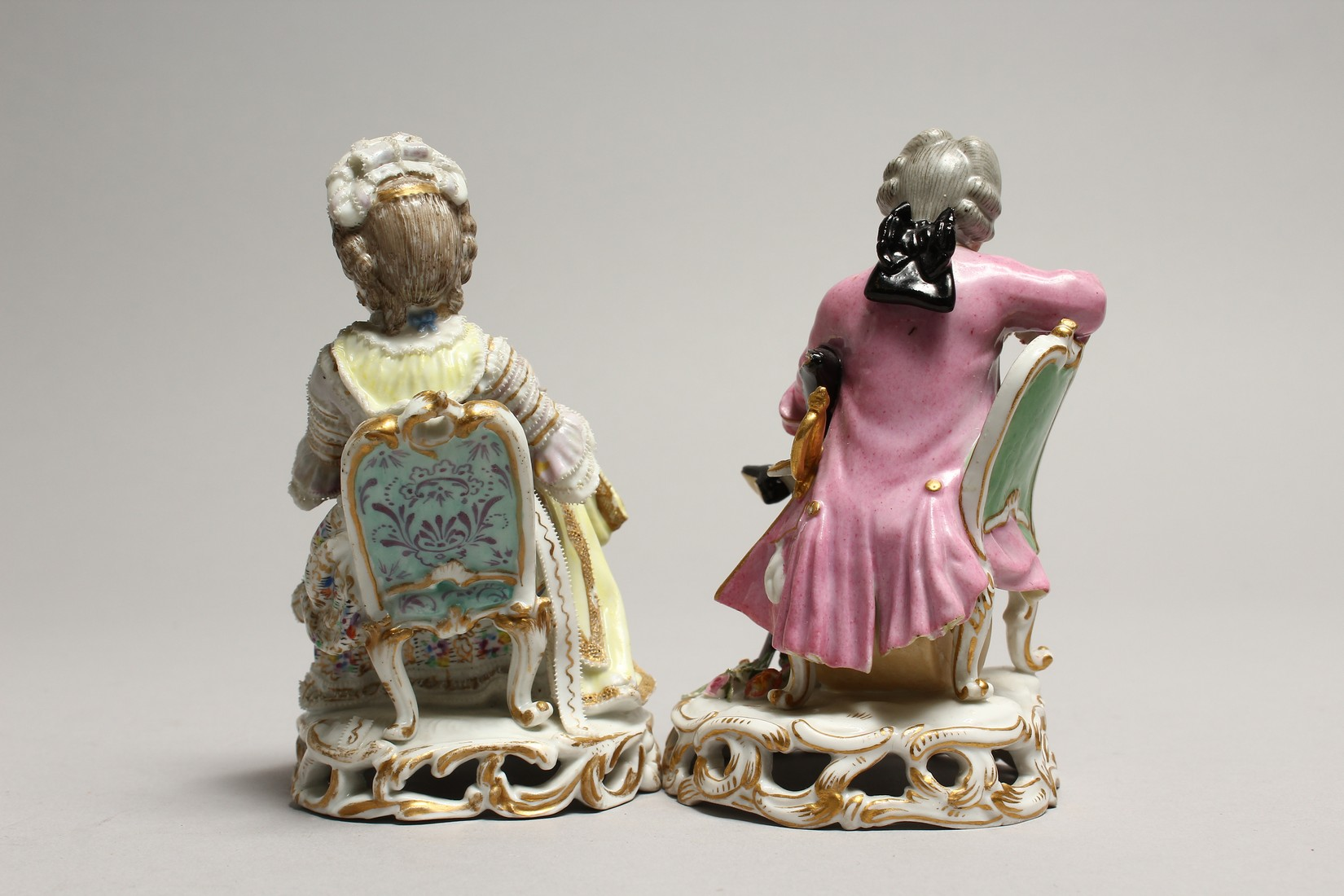 A GOOD PAIR OF MEISSEN PORCELAIN FIGURES, a young man reading a book, a girl sewing. Cross swords - Image 3 of 8