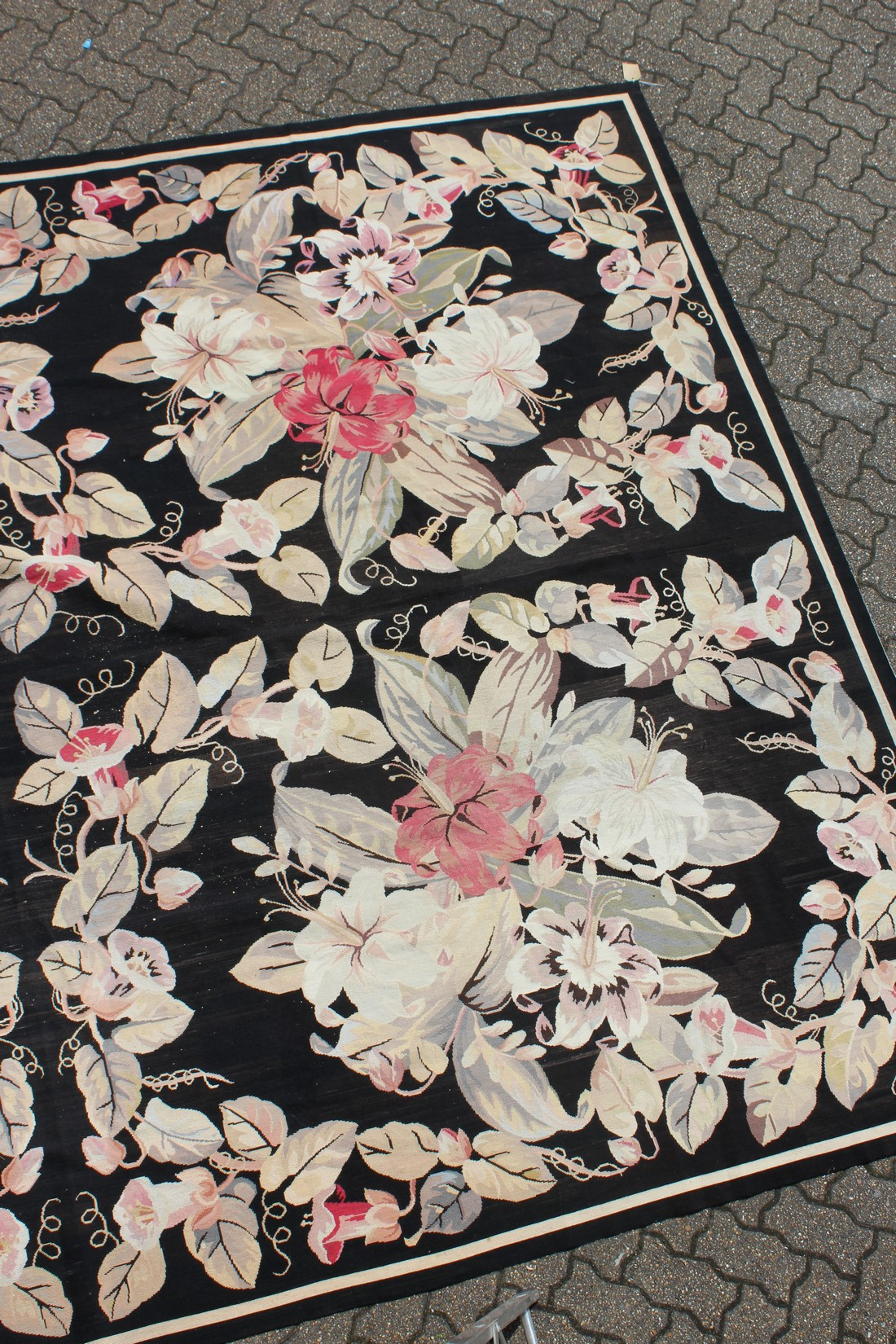 A LARGE ABUSSON STYLE TAPESTRY WALL HANGING, black ground, with floral decoration. 14ft 2ins x - Image 2 of 4