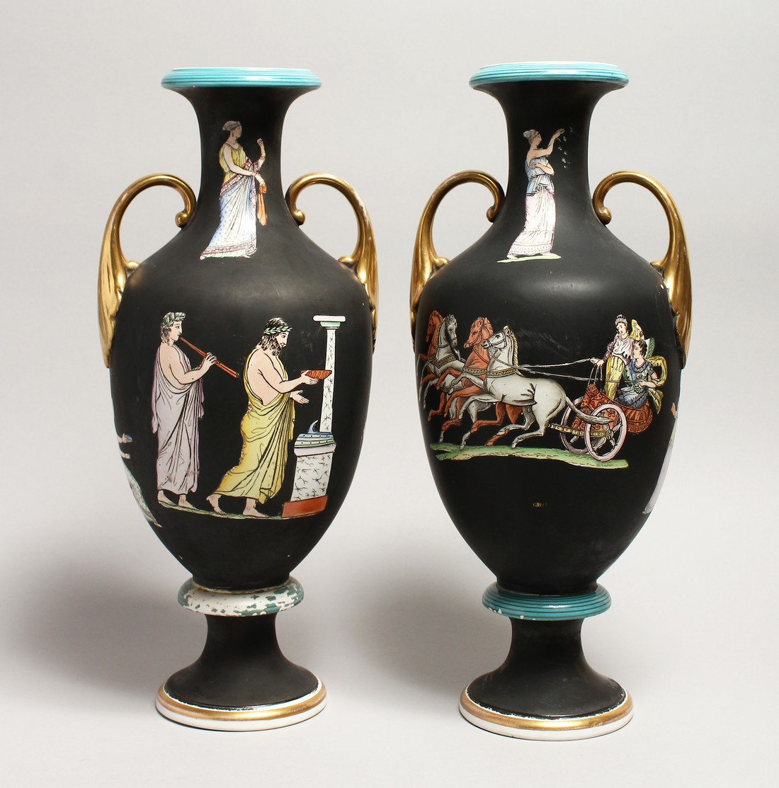 A PAIR OF CLASSICAL TWO HANDLED VASES with Greek figures 16ins high.