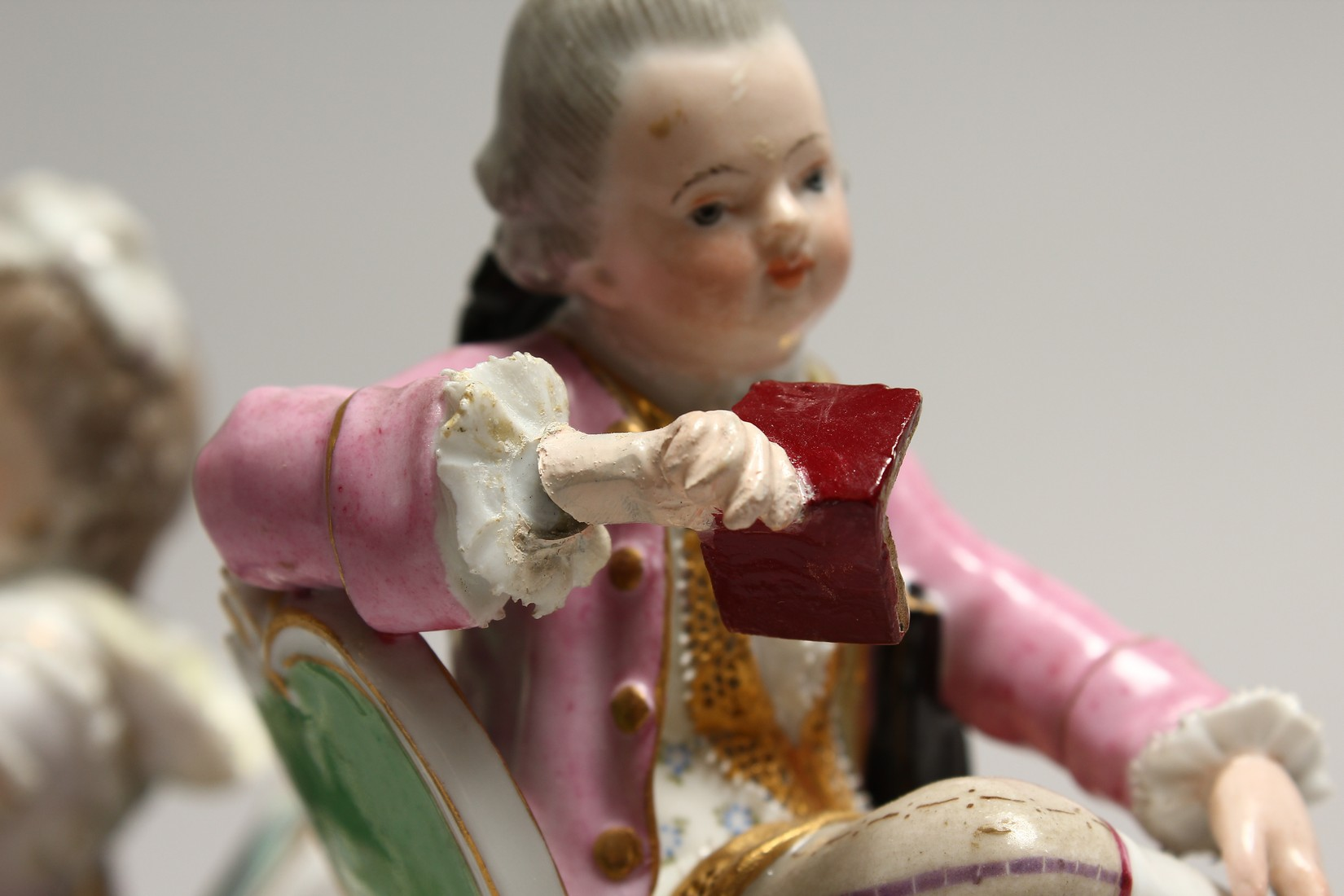 A GOOD PAIR OF MEISSEN PORCELAIN FIGURES, a young man reading a book, a girl sewing. Cross swords - Image 6 of 8