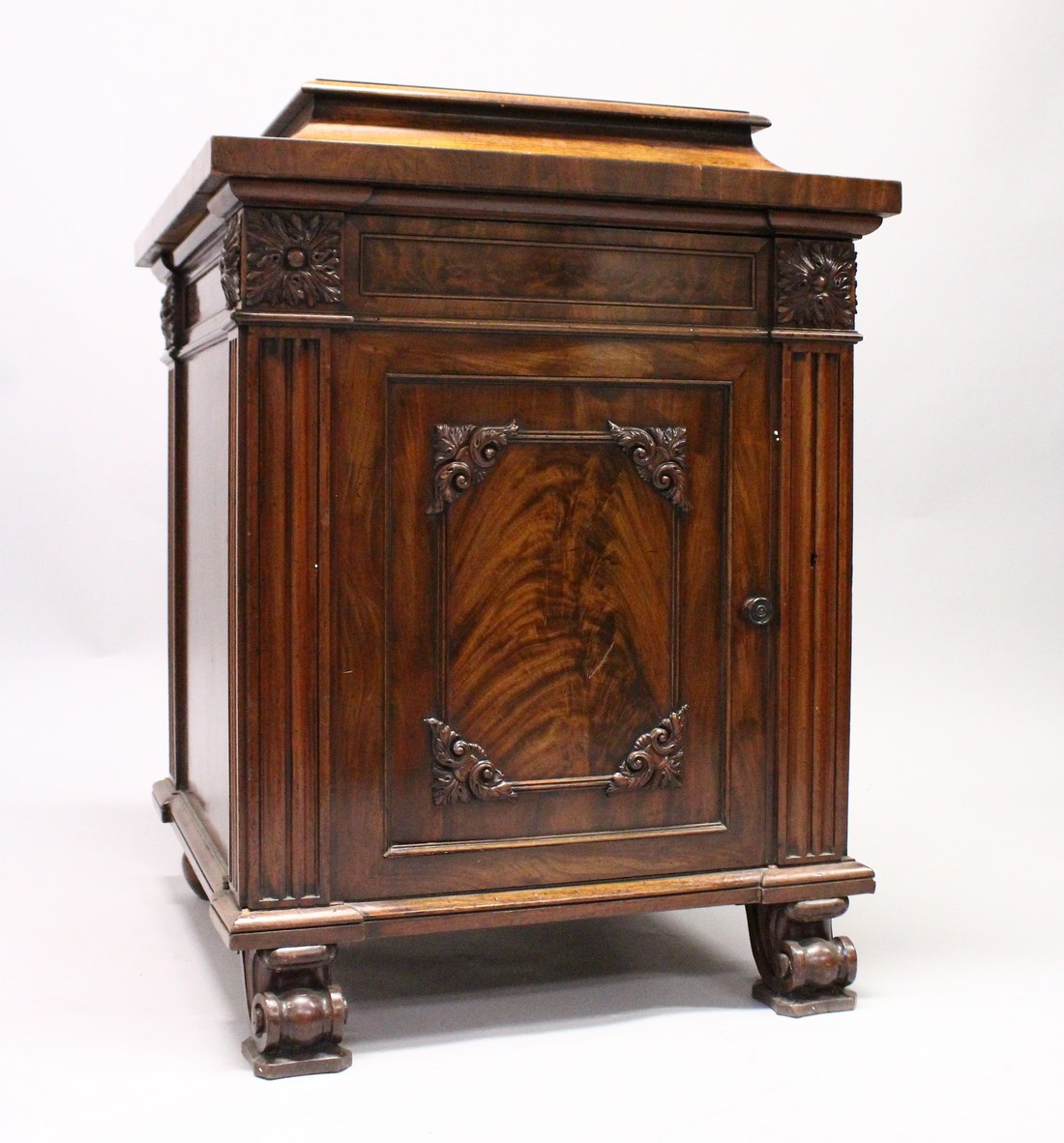 A GOOD 19TH CENTURY MAHOGANY PEDESTAL CUPBOARD, with a concave moulded top, panelled frieze with