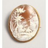 A LARGE 18CT GOLD OVAL CAMEO BROOCH, landscape, horse drawn cart.
