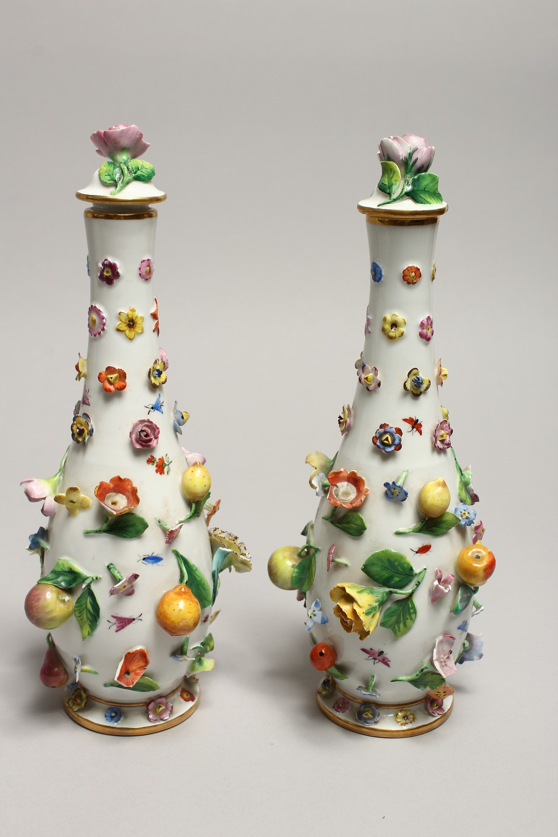 A GOOD PAIR OF MEISSEN FLOWER AND FRUIT ENCRUSTED VASES AND COVERS. Cross swords mark in blue. 10. - Image 4 of 8