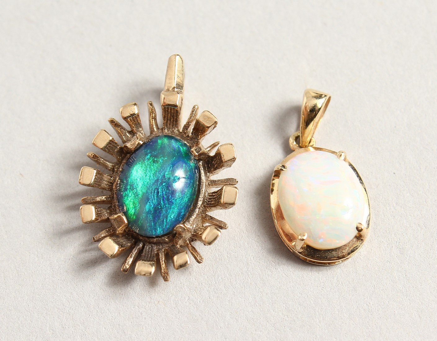 TWO SMALL GOLD OPAL PENDANTS