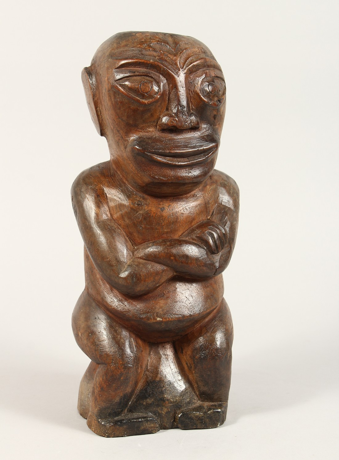 A CARVED WOOD POLYNESIAN FIGURE 18ins high