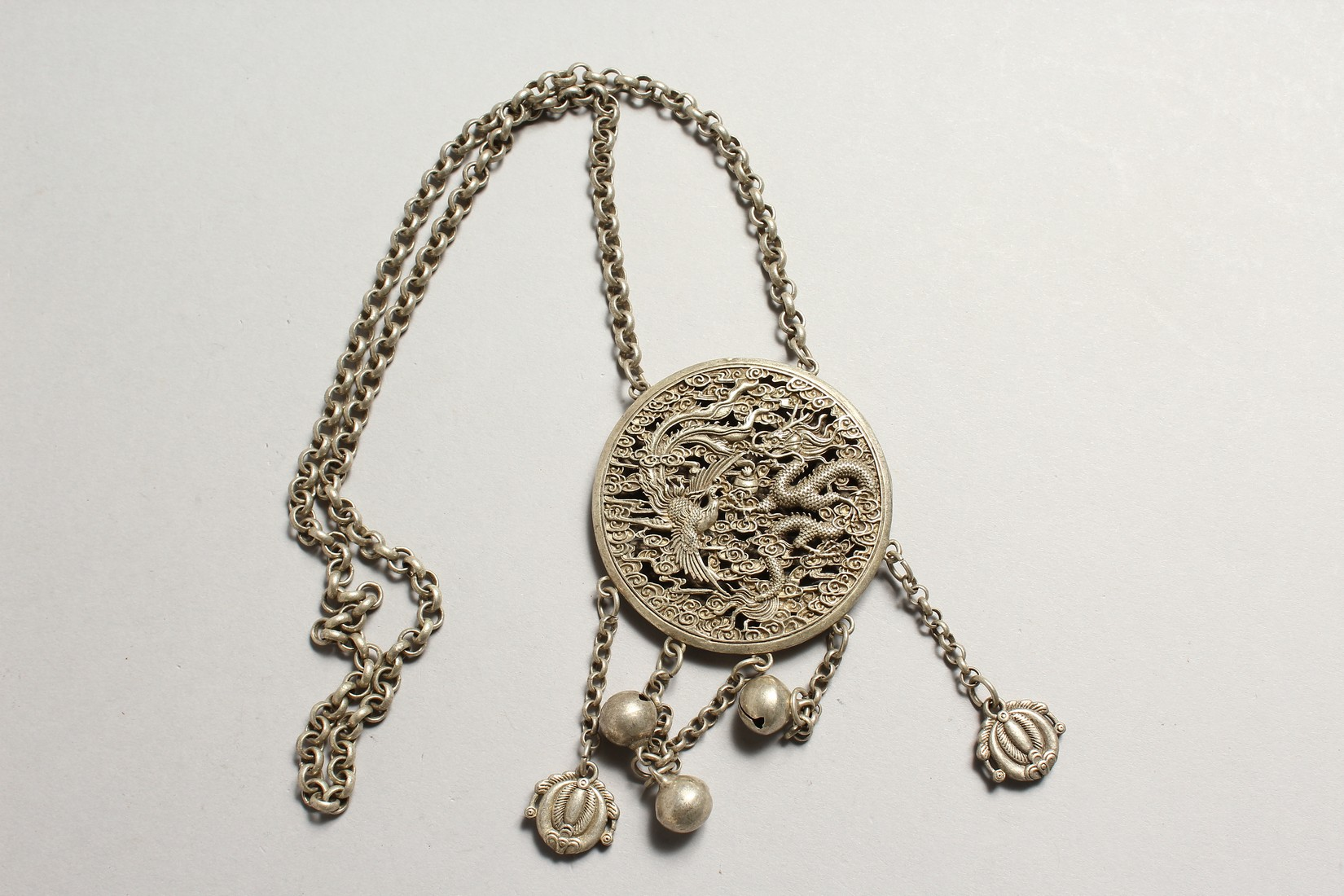 A CHINESE SILVER YIN-YANG PENDANT on a chain with dragon and phoenix. - Image 3 of 4