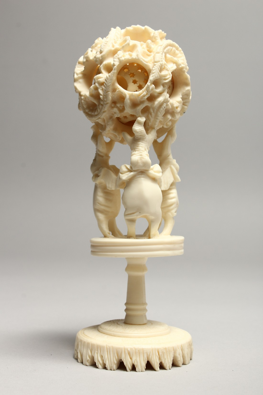A FAUX IVORY PUZZLE BALL on a stand. 7ins high - Image 2 of 2