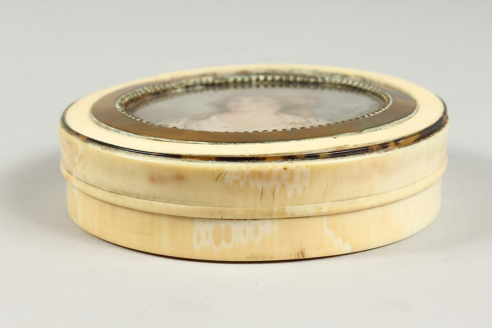 A GEORGIAN IVORY CIRCULAR BOX, the top painted with a portrait of Lady Mary Onslow. 3.75ins - Image 5 of 8