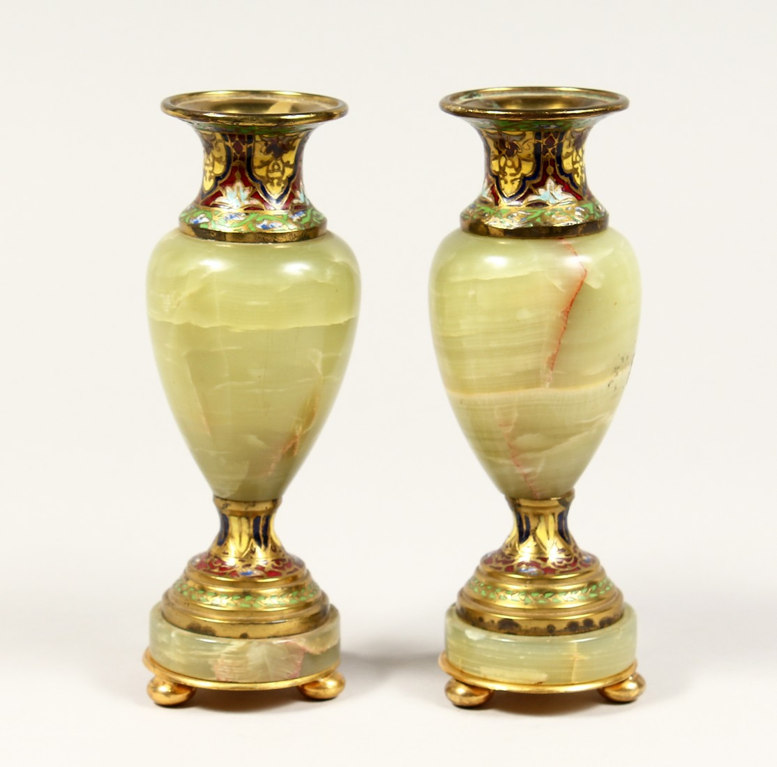 A GOOD SMALL PAIR OF FRENCH CHAMPAGNE ENAMEL AND ONYX VASES. 6.5ins high.