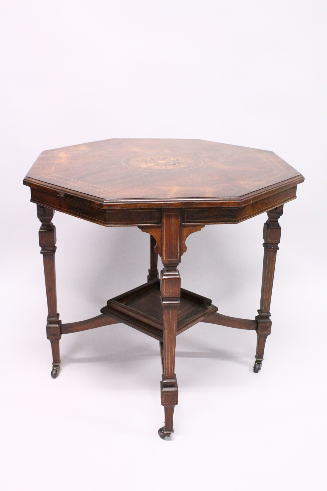A GOOD VICTORIAN ROSEWOOD OCTAGONAL CENTRE TABLE with inlaid top, tapering legs with casters and - Image 5 of 5